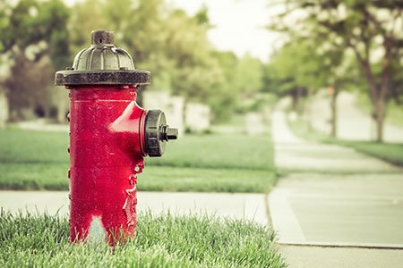 red fire hydrant on a residential street