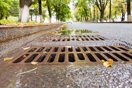 storm drain on rainy street